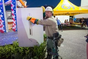 CEMC lineman Jame Crowder lights the midway during the opening ceremony of the 2016 Tennessee State Fair.